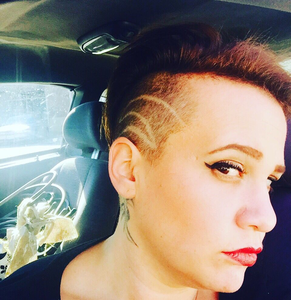 Womens cut shaved sides with design