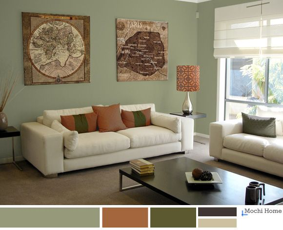 Warm sage green living room with rusty orange. See website