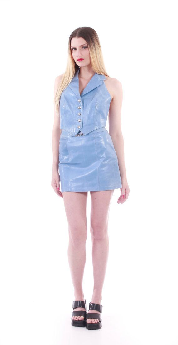 Incredible and rare 1990s lightly shiny periwinkle blue leather matching set. Slightly cropped collared halter top. Silver tone button front closure.