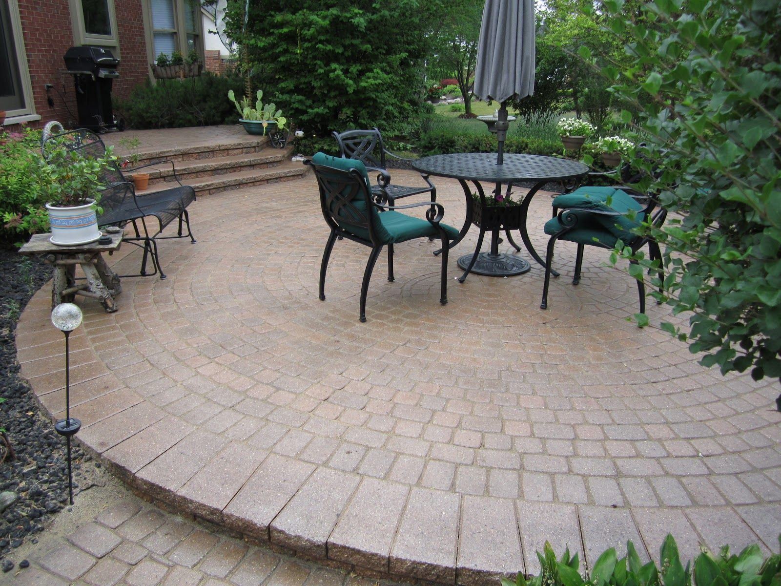 Elevated circular paver patio area with seating