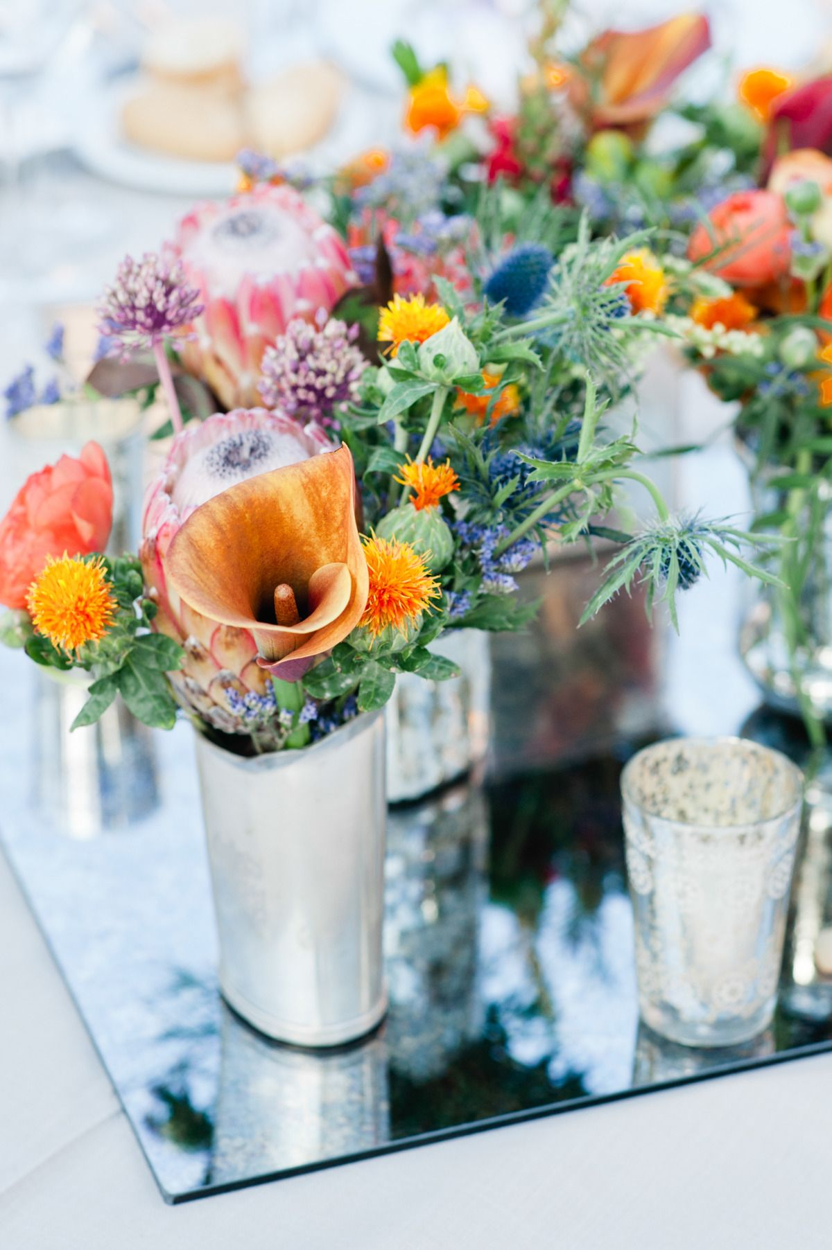 Colorful bunches of mixed blooms -- See the wedding here: http://www.StyleMePretty.com/2014/04/14/two-day-wedding-extravaganza-in-seville/ Leila Brewster Photography - www.leilabrewsterphotographyblog.com