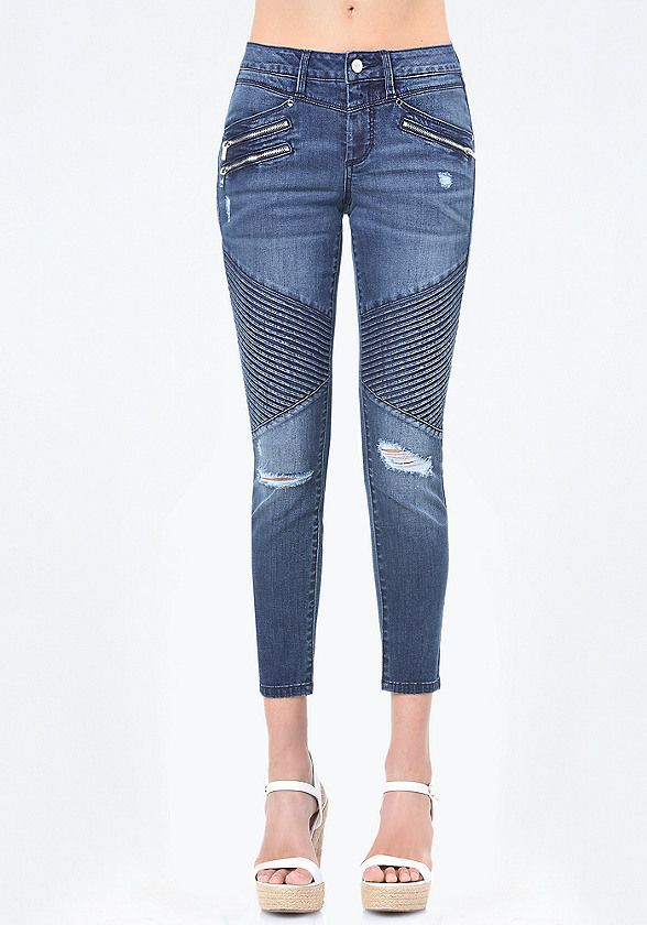 Moto finish. Wild-child crop jeans with edgy zip accents, pintuck detail and torn knees. 4-pocket styling. Front zip fly closure. Back bebe logo.