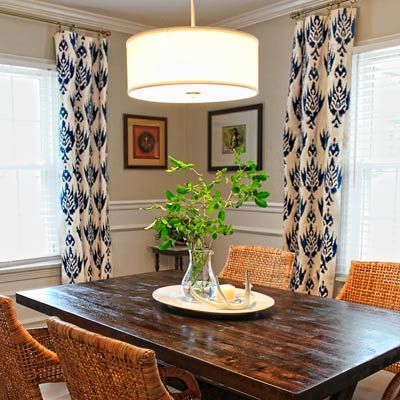 A pair of canvas drop cloths is transformed into two pairs of panels with just a stencil and navy craft paint mixed with textile medium. | Photo: Courtesy of Triangle Honeymoon | thisoldhouse.com