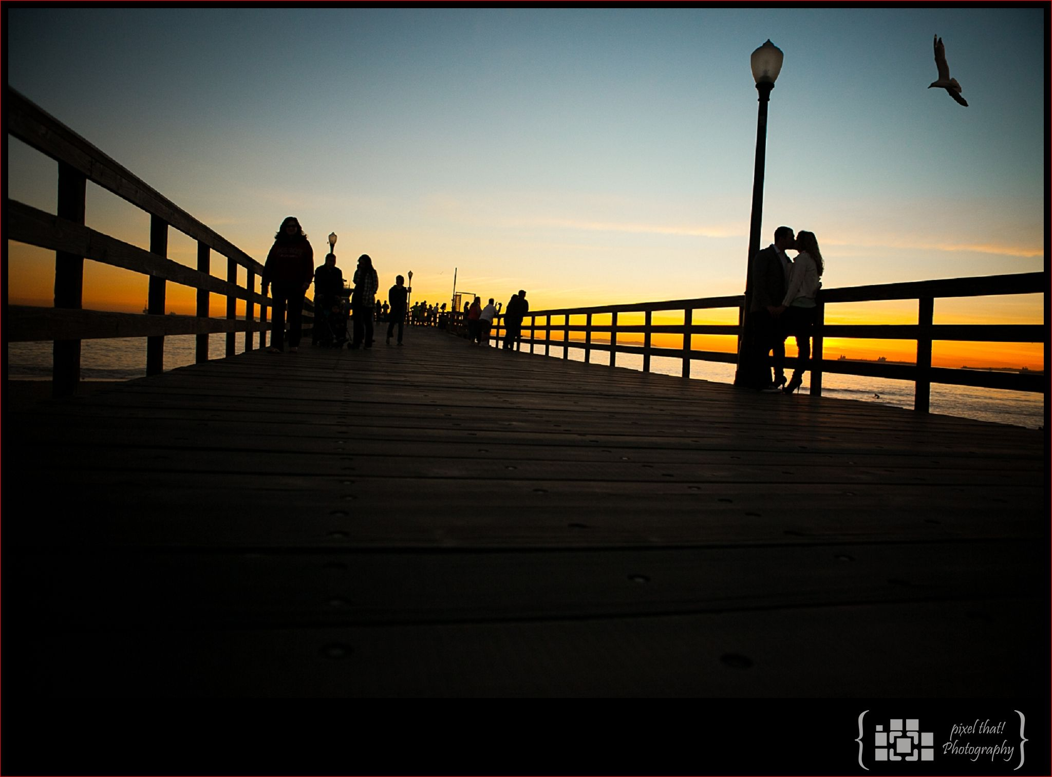 Seal Beach Pier.  Couple in Love.  Amazing Sunset. Check, check and CHECK!