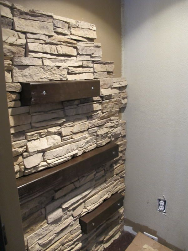 Faux stone sections with integrated wood shelves. Flank both sides of wall  mounted TV in basement?