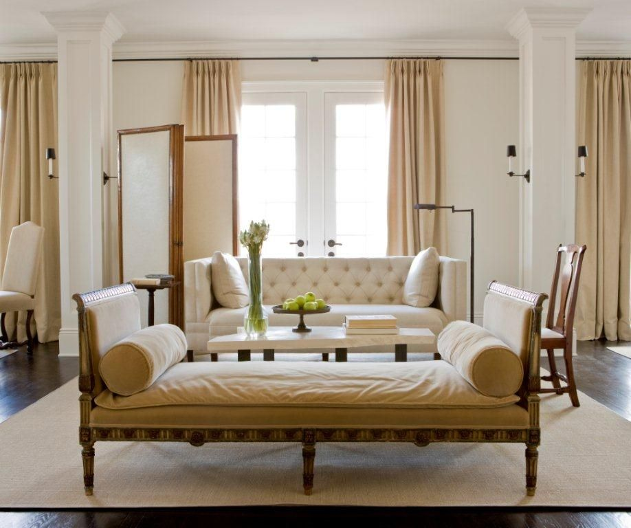 A Daybed Opposing A Tufted Sofa Keeps Visual Flow In This