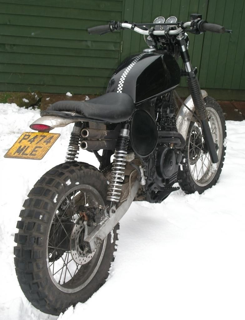 Honda NX 650...pair of rear shocks?! Nice retro mod.