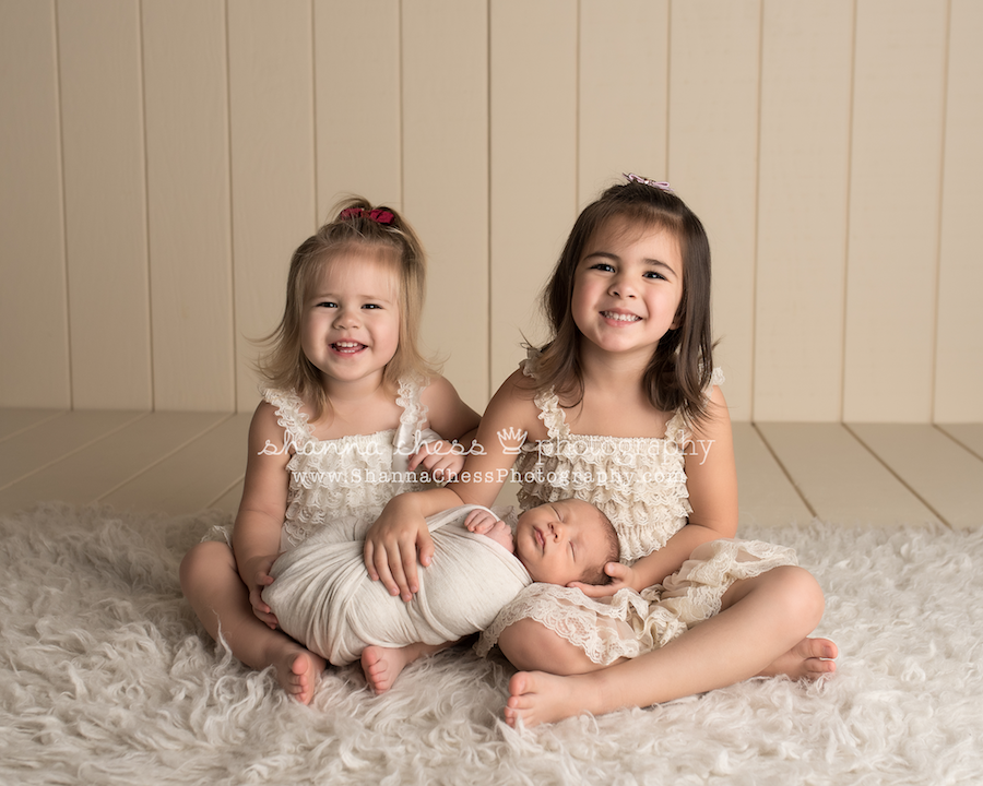 Newborn photography session with older siblings baby boy and big sisters pictures sibling photographs