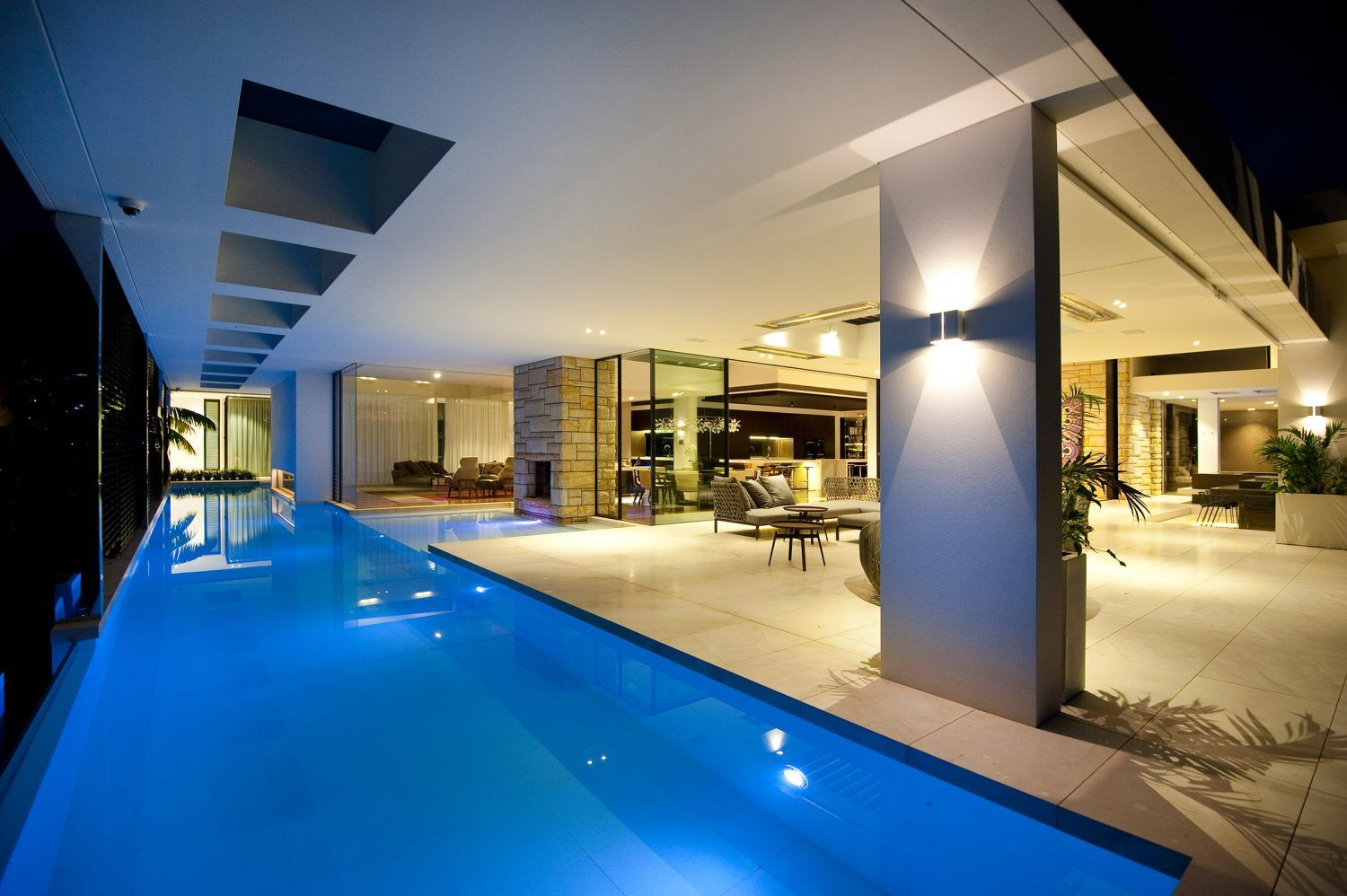 luxurious refreshing living space right next to the stunning olympic size pool which creates a bluish