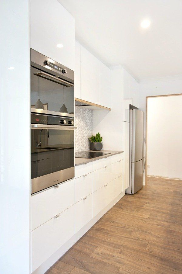 can you believe this couple 39 s sleek kitchen is from ikea kitchen cabinets k che. Black Bedroom Furniture Sets. Home Design Ideas