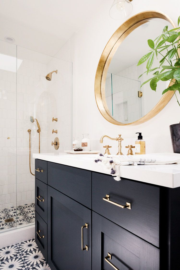 Images Photos White walls floral tiled floors black drawers gold faucets and gold framed