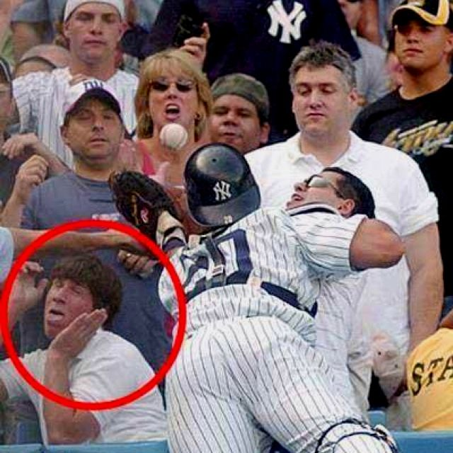 """This guy was too busy """"Voguing"""" to realize that a serious baseball maneuver was in motion. :-D"""