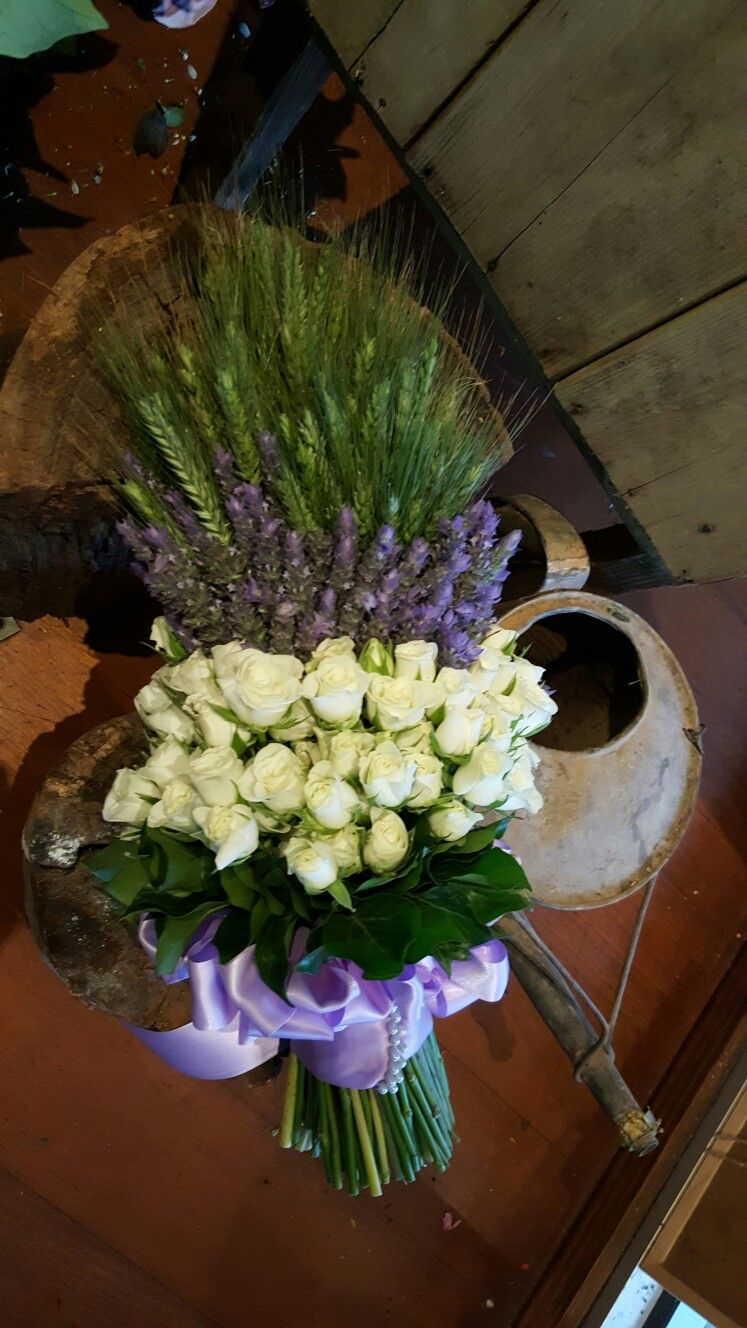 Classic style lavender, rose and wheat bouquet. This