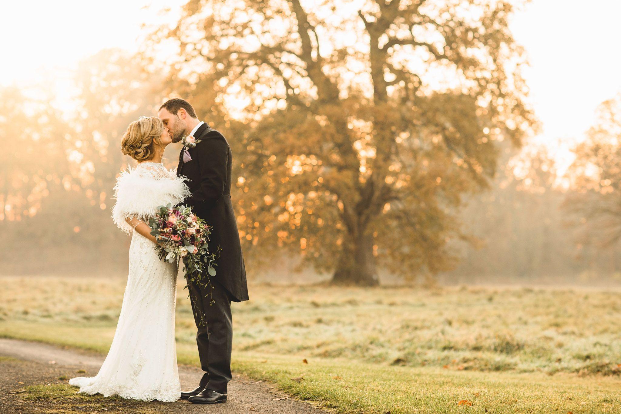 a beautiful sunset kiss at iscoyd park winter wedding