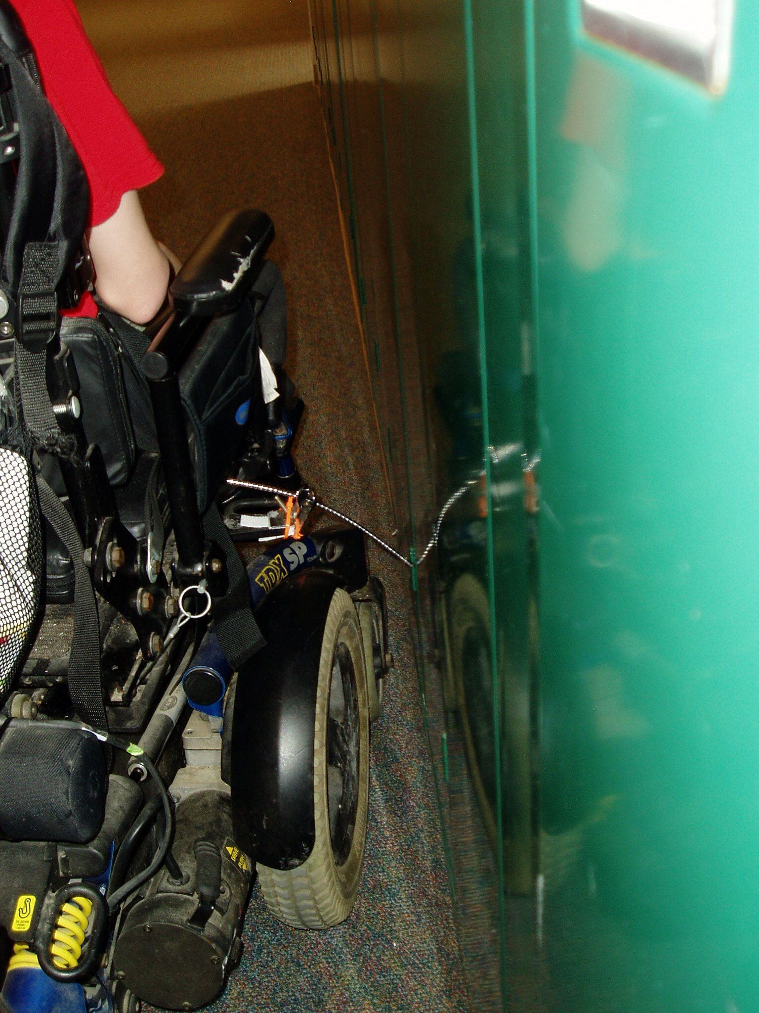 Attach curb feelers to wheelchairs used by individuals with