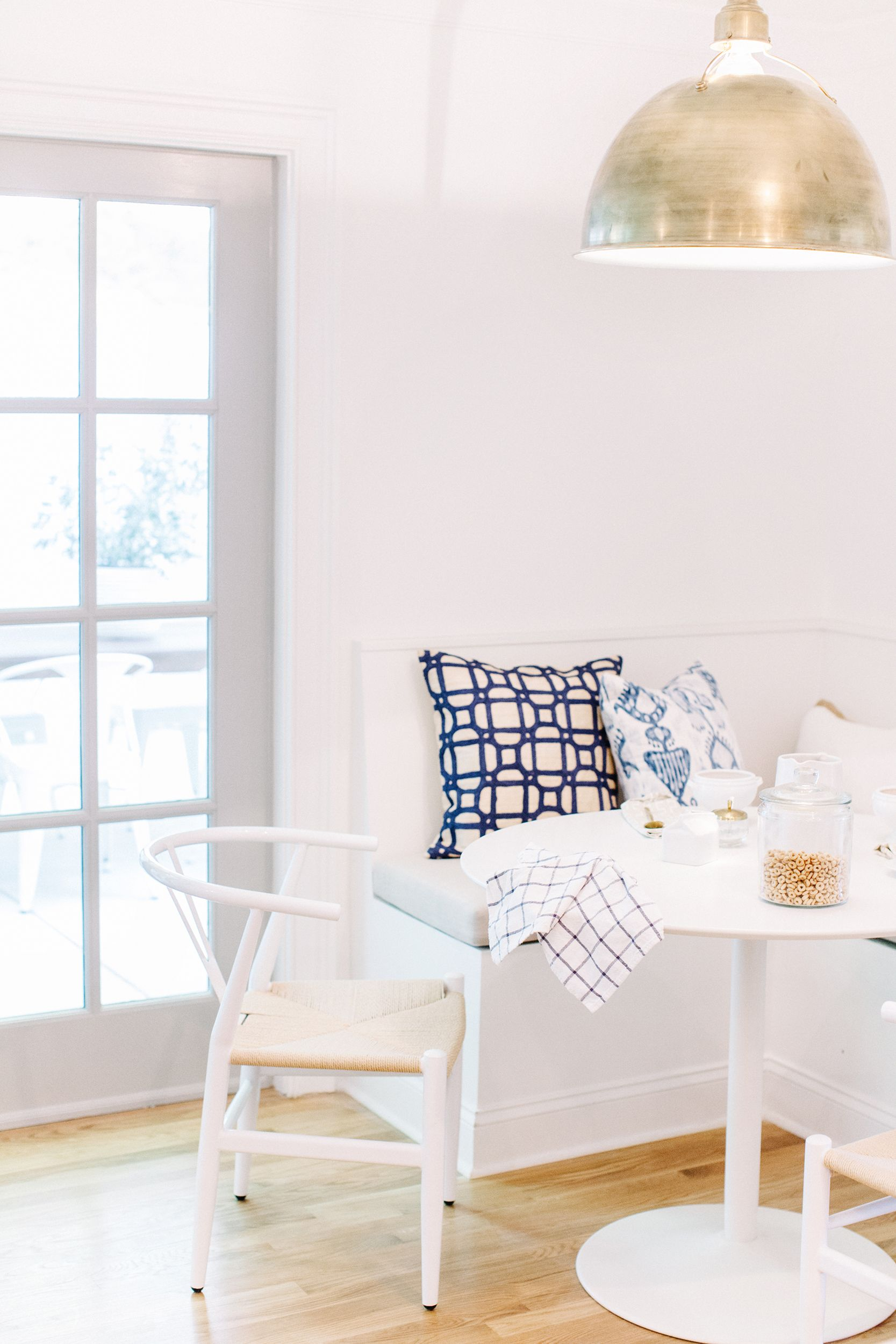 White kitchen, banquette. Breakfast nook. Design+styling by Pencil ...