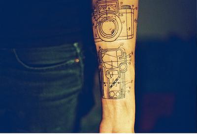Camera arm tattoo