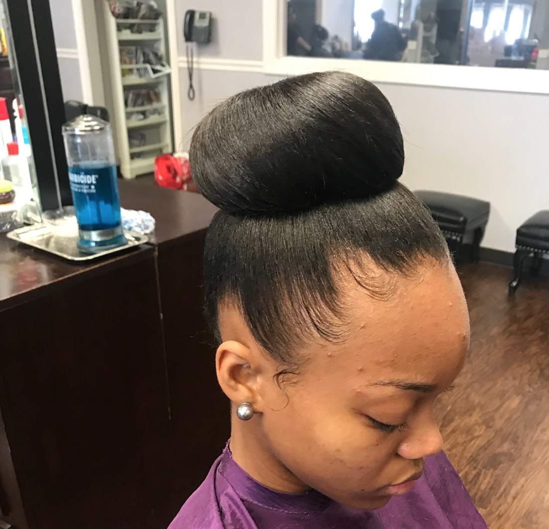 Classic Bun Via Herhairstudio Https Blackhairinformation Com Hairstyle Gallery Classic Bun Via Herhairst Top Knot Hairstyles Relaxed Hair Weave Hairstyles
