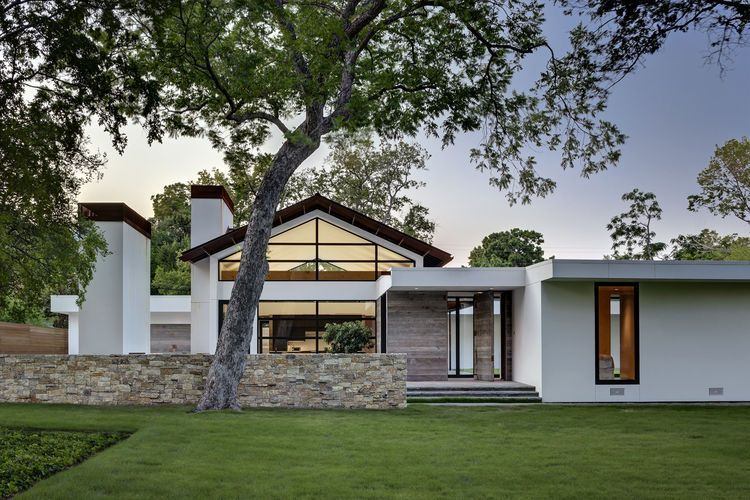 Renovated ranch home with stucco, limestone walls and