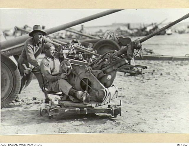Australians trying out a German Dual Purpose Flak Gun (effective against low flying aircraft) - AWM