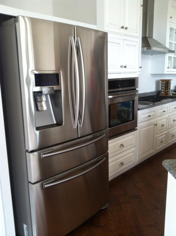 Kitchen Hardwood Flooring French Door Refrigerator Stainless Steel White Distressed Cabinets