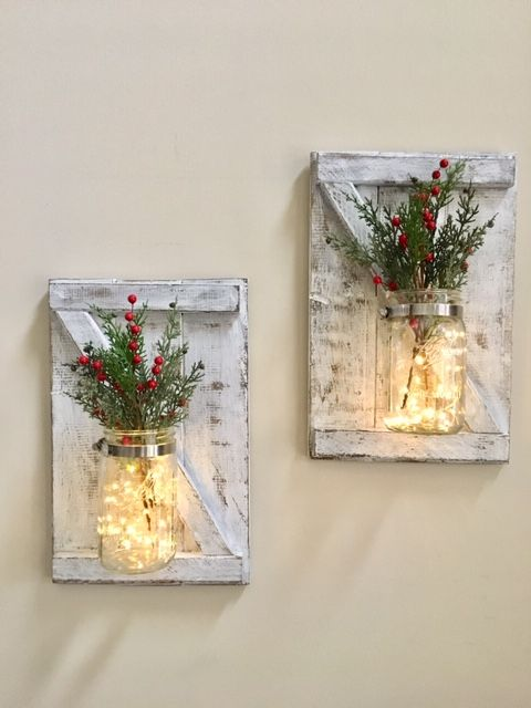 How cozy are these Christmas sconces? And you can easily switch out the greenery with the seasons to match your home decor!  #christmas #farmhousechristmas #christmasgifts #christmasdecor #rusticchristmas $rustichomedecor #farmhousedecor #rusticchristmasdecor #sconces #cozyhomedecor #cozysouthernhome #christmasdecorations