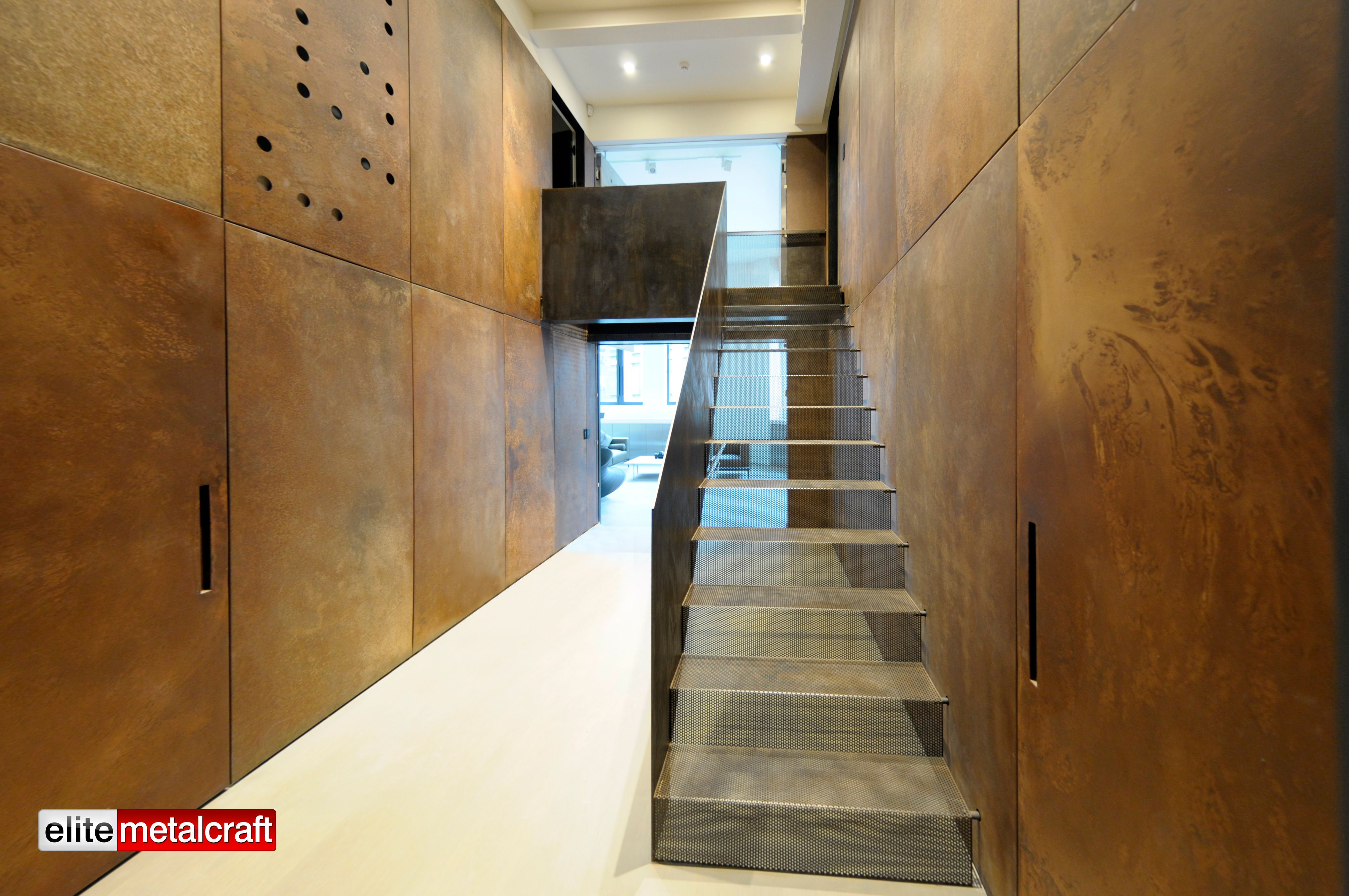 Staircase was constructed using a custom made perforated for Unique interior wall finishes