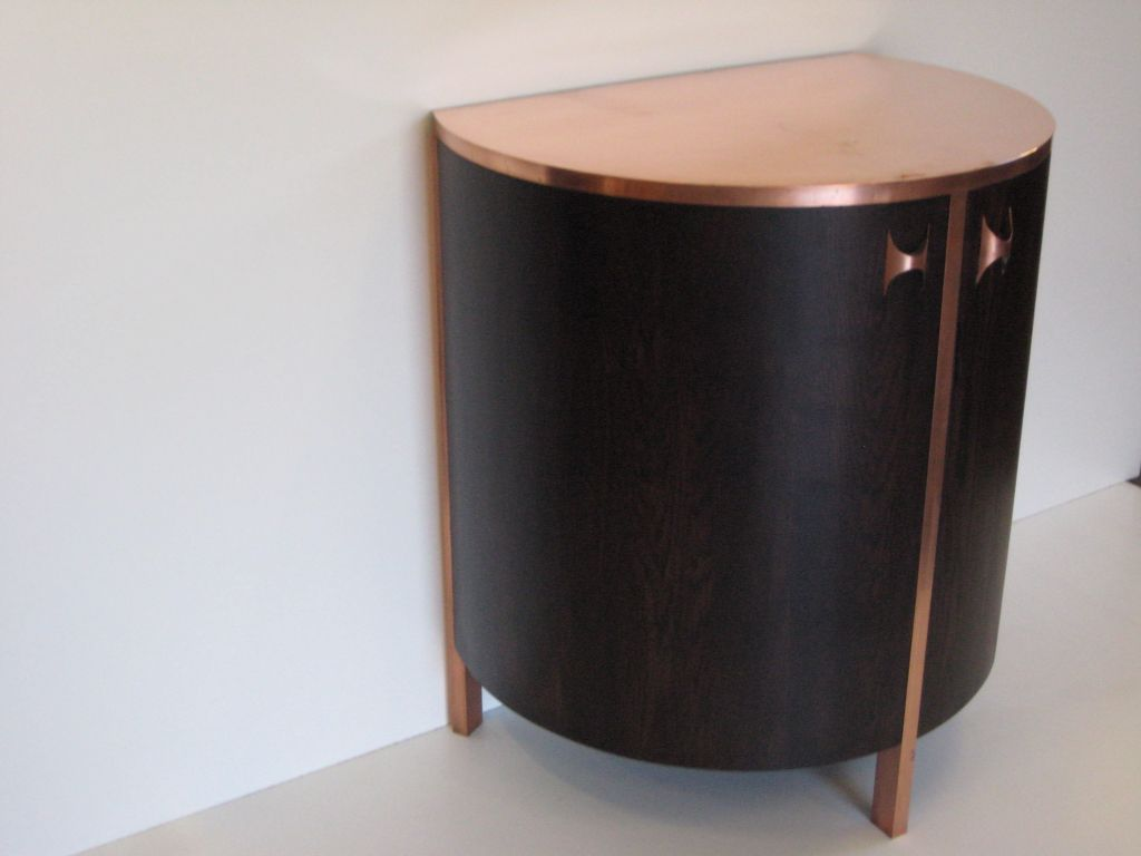 Drinks cabinet commission copper and stained oak with glass shelves.