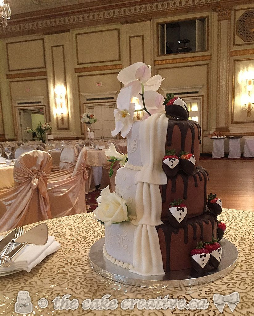 """https://flic.kr/p/vBJMuf   Two-in-one Wedding Cake, or as the bride dubbed it """"double the fun"""" cake. Vanilla cake with chocolate butter cream filling and icing, covered with chocolate marshmallow fondant then followed by regular marshmallow fondant. White side of the cake decorated with butter cream piping details, gorgeous white flowers and fondant draping. Chocolate side """"dripped"""" with chocolate and adorned with cute tuxedo dipped strawberries."""