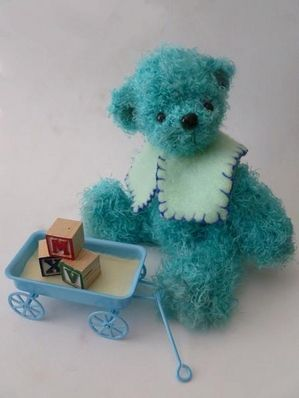 Richard's accessories include a handmade collar and a tiny metal cart with mini building blocks. crocheted bears one of a kind, bearkidz® by Marion Fraile Available bears