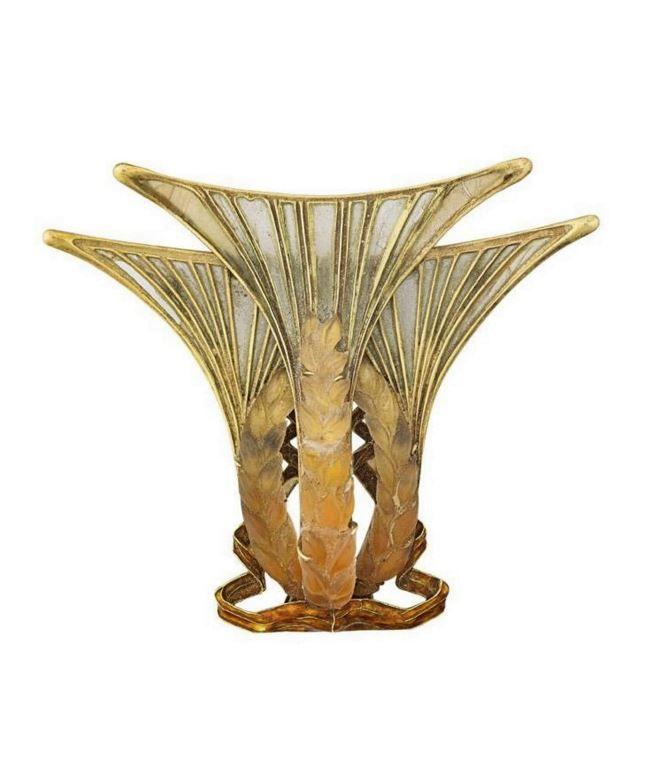 RENÉ LALIQUE | ART NOUVEAU PLIQUE-A-JOUR PRESSED GLASS GOLD JEWEL. In the form of stylized wheat ears and ribbons, translucent pâte de verre seeds over shaded enamel, opalescent plique-à-jour beards, translucent copper-tone enamel ribbon spirals, ca. 1903-1905.