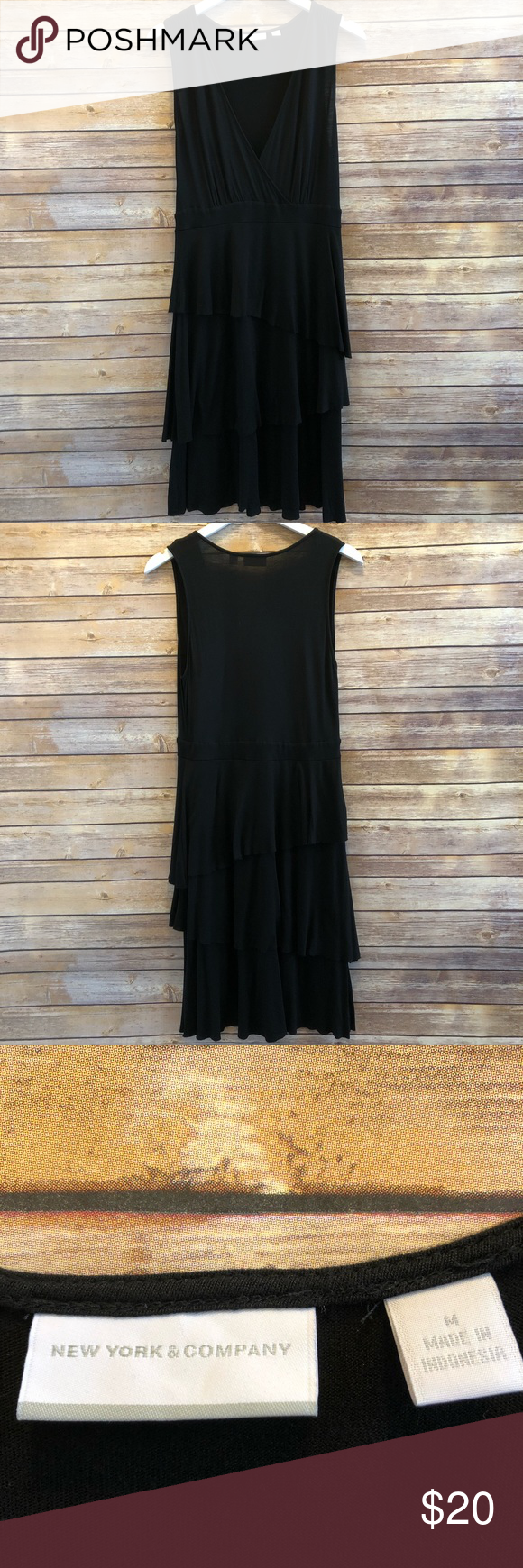 "New York & Company Sleeveless Dress Size Medium New York & Company sleeveless black dress.  Size Medium.  Excellent condition.  Only worn once.  Body 100% rayon.  Lining 100% polyester.  Machine wash, flat dry.  Measures approximately 17"" armpit to armpit, 40"" length. New York & Company Dresses #blacksleevelessdress"