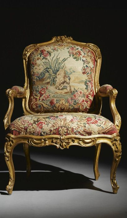 A pair of carved giltwood Beauvais tapestry upholstered fauteuils à la Reine, stamped C. Sené Louis XV, circa 1750