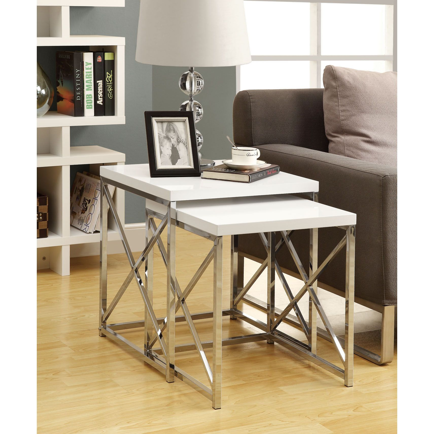 Use this set of 2 gloss white chrome metal nesting tables in a