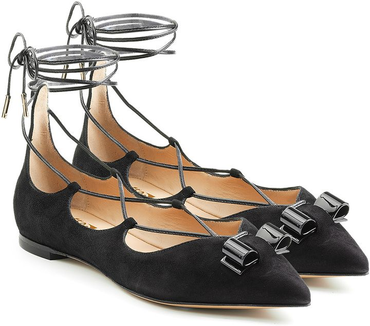 Complete with a sculptural bow and delicate ankle strap, the Claire flats from Salvatore Ferragamo are perfection.