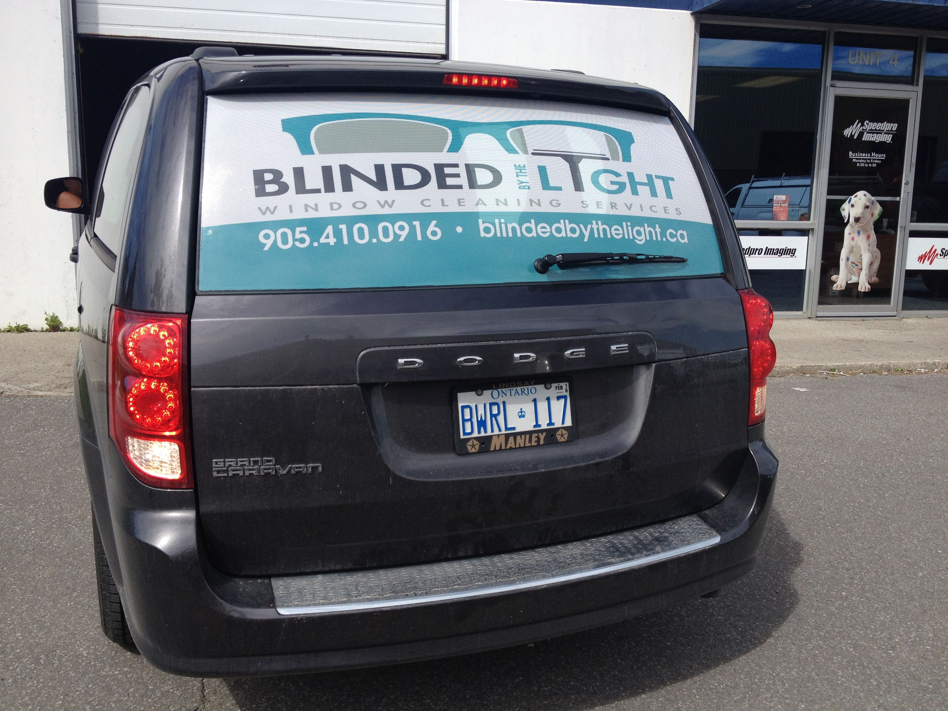 Rear window graphics digital print on perforated vinyl with optically clear laminate