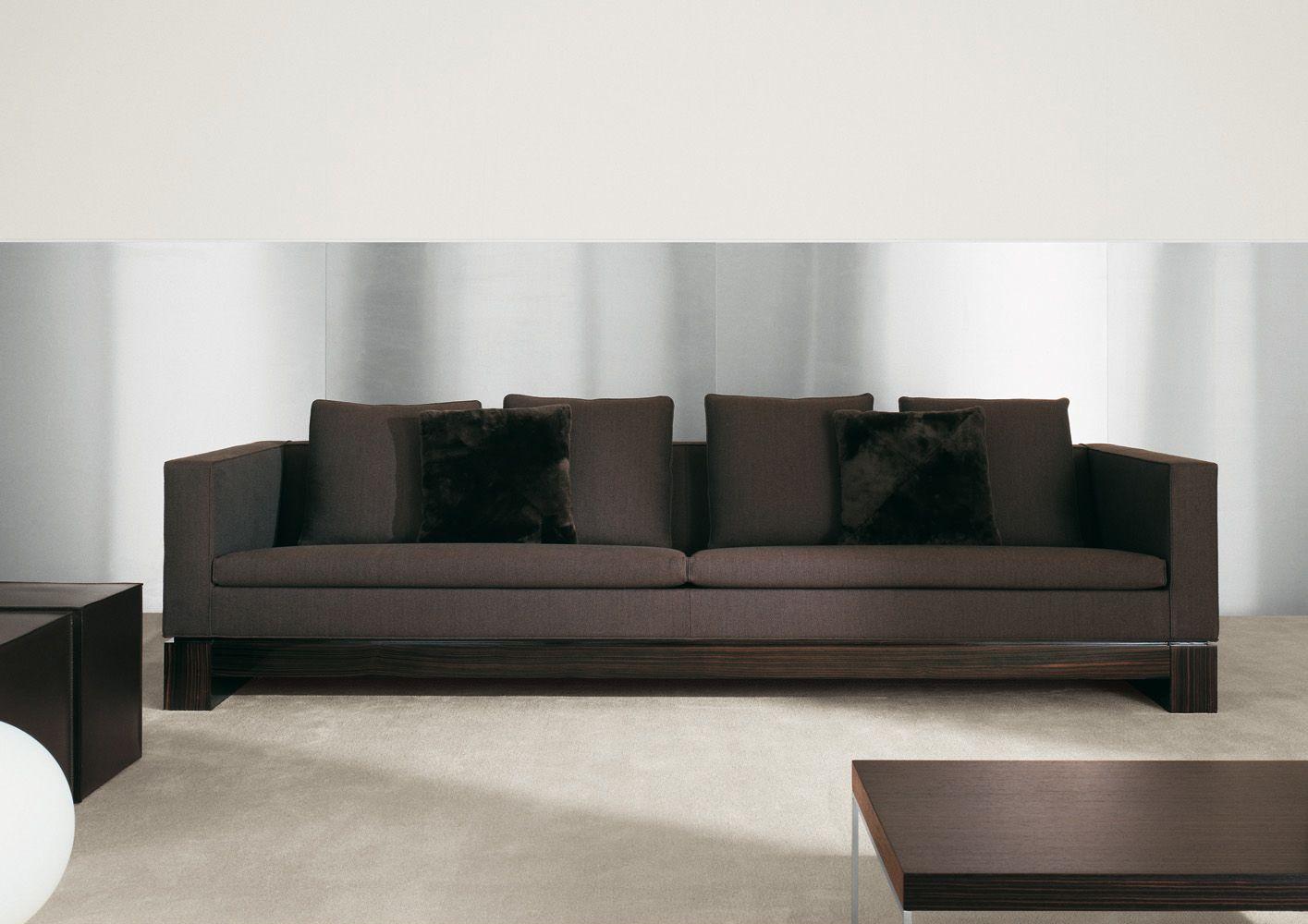 Minotti | Klimt, a base finished in glossy polyester ebony, evoking the  decoration and