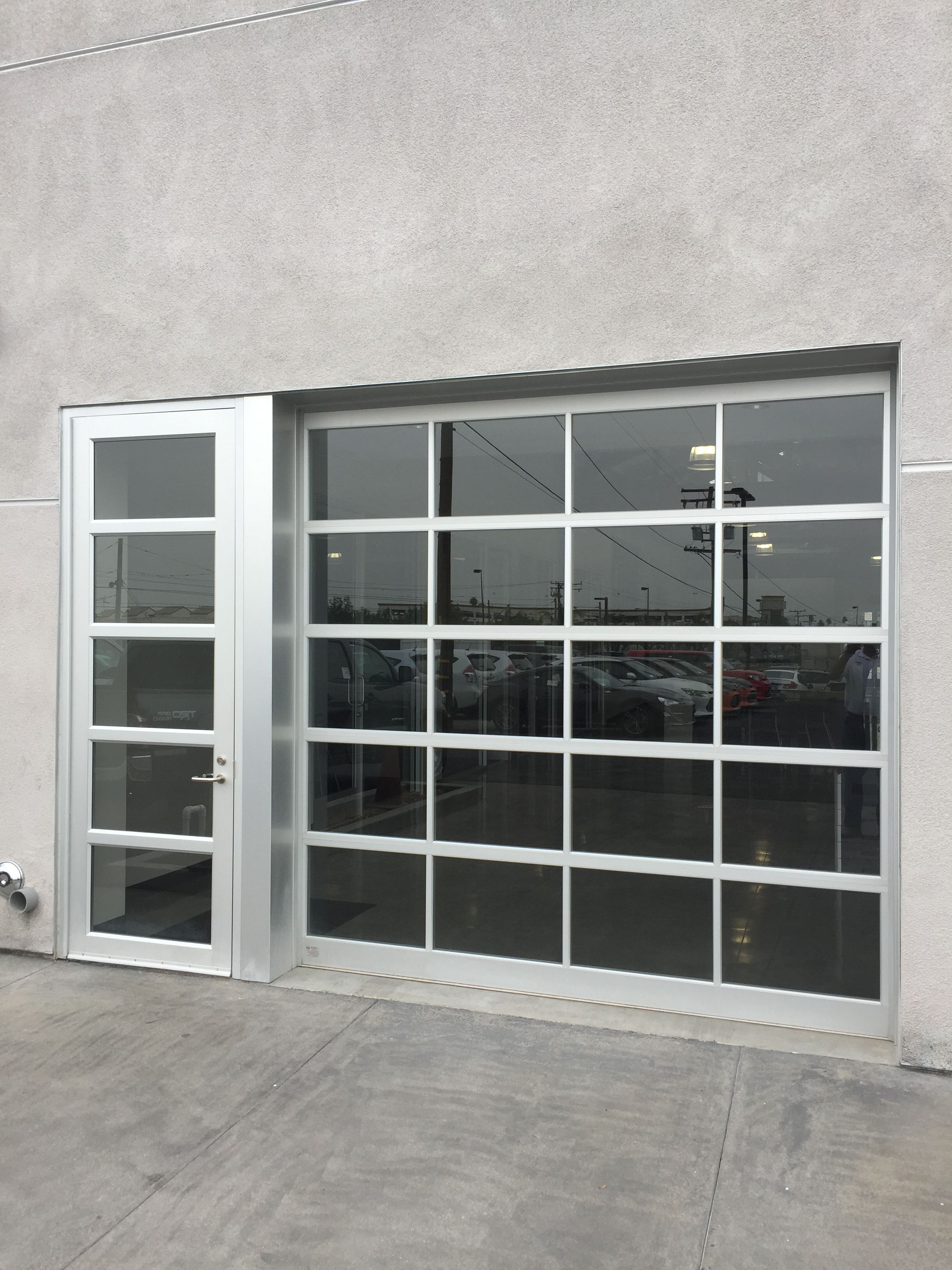 Glass Garage Doors Store Fronts And Combos With Images Garage Doors Glass Garage Door Garage Door Store