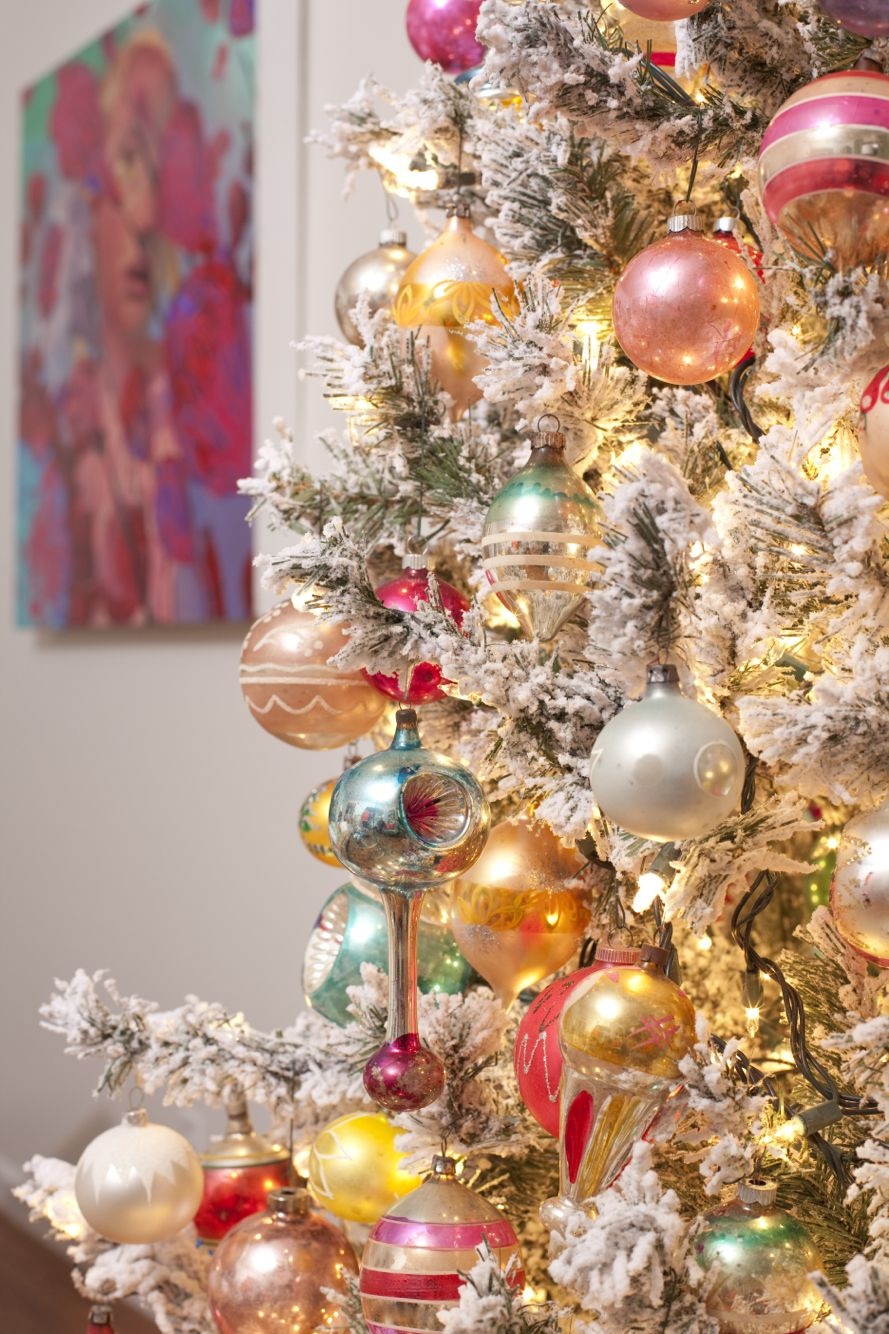 Christmas tree flocked with vintage glass ornaments