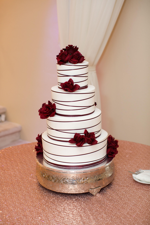 Four Tier White Wedding Cake With Burgundy Accents Arizona Wedding Photographers Villa Tuscan Burgundy Wedding Cake Blush Wedding Cakes Wedding Cake Rustic