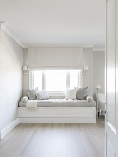 white color window seat | This cozy corner with radiant natural light features a ...