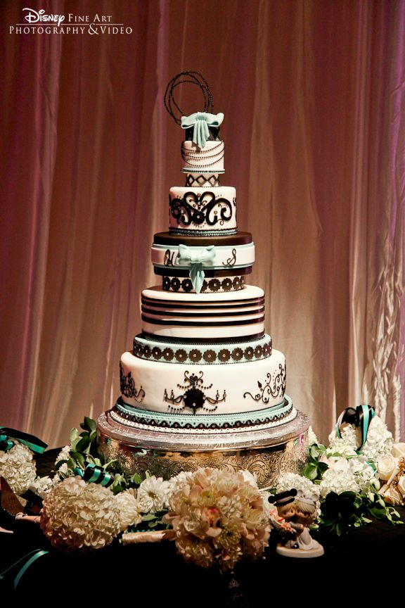 Black and turquoise art deco cake accented with bows and lavish ornamentation