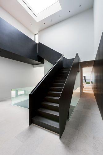 Lake Minnetonka Retreat Home, designed by Snow Kreilich Architects. #modern #stair #interior