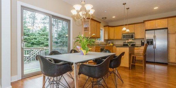 Great kitchen and dining space with modern table and chairs! Natural cabinets.