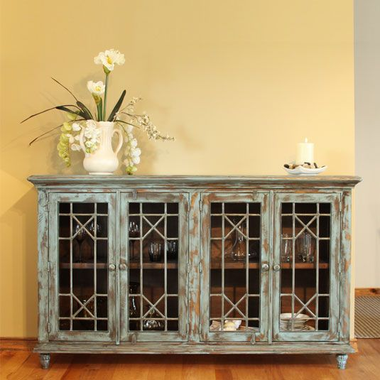 bring the elegant beauty of the vintage four door console into your home its nine step hand rubbed finish hand forged iron and fixed shelf for
