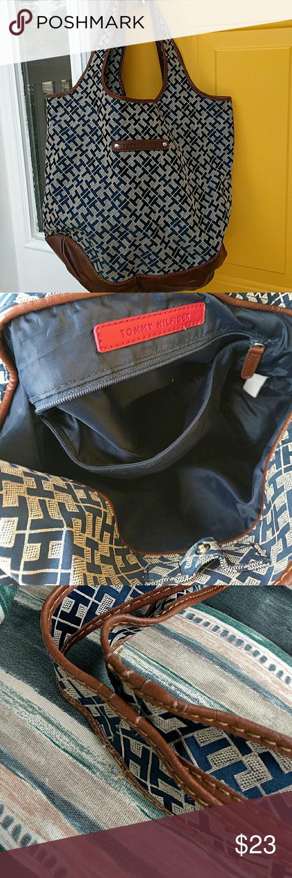 Tommy Hilfiger tote Tommy Hilfiger tote bag.  Canvas/leather. Slight wear on shoulder straps but still GUC Tommy Hilfiger Bags Totes