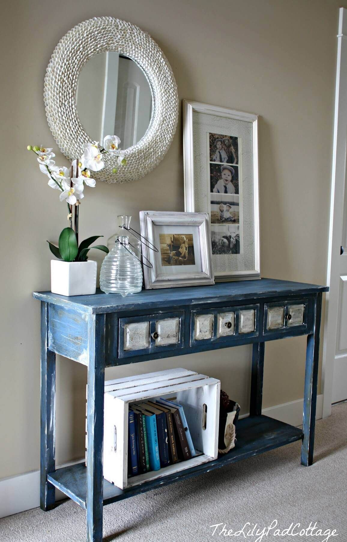 White décor accents on distressed blue entry small entryways entryway decor hall table decor