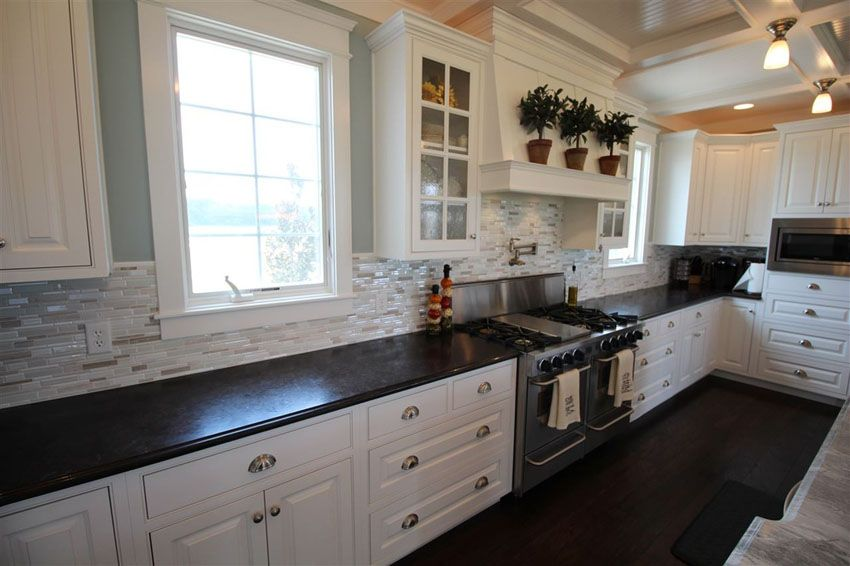 Traditional Galley Kitchen With White Cabinets And Ceramic Tile Backsplash