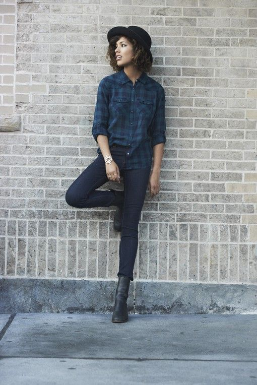 Bowler hat, checkered shirt, skinny jeans, boots