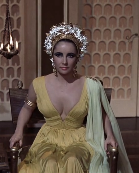 Cleopatra is listening carefully to Caesar's plans http://mariaefmilliner.com/cleopatra-a-review-of-the-35-dresses-she-wears-on-the-movie/
